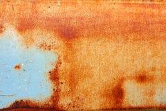 Roter Rost auf altem blauem Metallbeschaffenheits-Oberflächenhintergrund Stockfotos