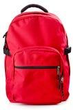 Roter Rucksack, der auf weißem Hintergrund steht Stockfotografie