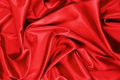 Roter Satin oder Seidengewebe stockbilder
