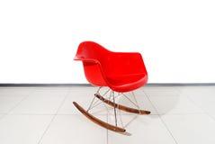 Roter Schaukeln-Stuhl Stockbild