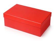 Roter Schuhkarton lokalisiert auf Weiß Stockfotos