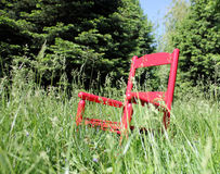 Roter Schwingstuhl Lizenzfreies Stockfoto