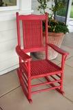 Roter Schwingstuhl Stockfoto