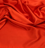 Roter Seidengewebehintergrund Stockfoto