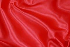 Roter Silk Stoff des gewellten abstrakten Hintergrundes Lizenzfreie Stockbilder