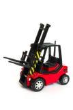 Roter Spielzeuggabelstapler Stockfoto