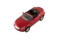 Roter Sport spielt Auto mit Ausschnittspfad Stockbilder