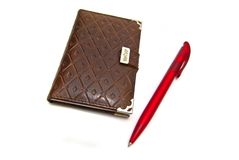 Roter Stift und Notizbuch lizenzfreie stockfotos