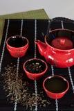 Roter Teacup Stockfotos