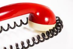 Roter Telefonsprecher mit Draht Stockfoto