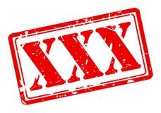 Roter Text des Stempels XXX Stockfotos