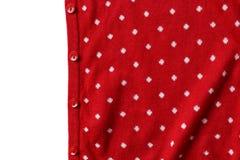 Roter Tupfenstrickpulli mit Knopf Lizenzfreie Stockfotos