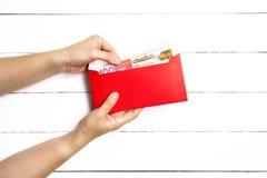 Roter Umschlag oder rotes Paket für Geschenke des Chinesischen Neujahrsfests Lizenzfreie Stockfotografie