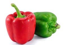 Roter und grüner süßer Pfeffer auf einem weißen Hintergrund Stockfotografie