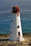 Roter und weißer Leuchtturm Stockfotografie