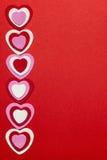 Roter Valentinsgrußtageshintergrund mit Herzen lizenzfreies stockfoto