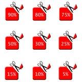 Roter Verkauf etikettiert mit Rabatt - schneiden Sie durch Scheren Lizenzfreie Stockfotografie