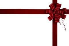 Roter Weihnachtsbogen und -band Stockfotografie