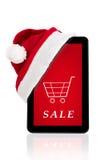 Roter Weihnachtshut auf Tablette, Weihnachtsverkauf Stockbild