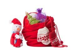 Roter Weihnachtssack und -Schneemann,   Lizenzfreie Stockfotografie