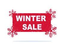 Roter Winterschlussverkaufaufkleber mit Schneeflocken Stockfotos