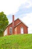 Roter Ziegelstein-Schulhaus Stockbilder