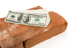 Roter Ziegelstein und Dollar Lizenzfreies Stockbild