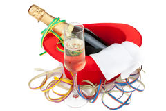 Roter Zylinder mit Champagner und Glas Stockfotografie