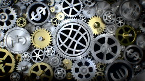 Roterande global jordsymbol i kugghjulenhet med det olika valutatecknet