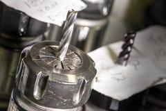 Roterande huvud för CNC med metalldrillborren Arkivbilder