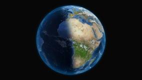 Roterande planetjord p? en fast svart bakgrund royaltyfri illustrationer