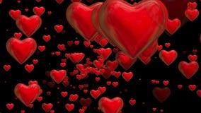 Roterande röda hjärtor på svart stock illustrationer