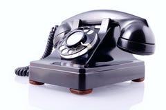 roterande tappning för svart telefon för clippingbana Arkivfoto
