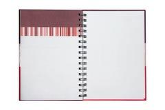 Rotes Anmerkungsbuch des Isolats auf Weiß Lizenzfreie Stockfotografie