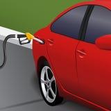 Rotes Auto mit einem Schatten auf einer Tankstelle Lizenzfreies Stockbild