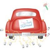 Rotes Auto mit gerade verheiratetem Zeichen Lizenzfreies Stockbild