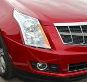 Rotes Auto Stoß-Front Quarter vom Auto lizenzfreie stockbilder