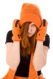 Rotes behaartes Mädchen im orange Hut Lizenzfreie Stockbilder