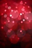 Rotes bokeh beleuchtet Hintergrund Stockfotografie