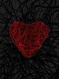 rotes Drahtinneres und schwarzer Drahthintergrund Stockfotos