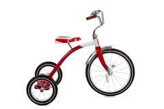 Rotes Dreirad auf Weiß Stockfoto