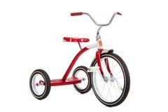 Rotes Dreirad auf Weiß Stockfotos