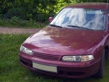 Rotes Familienauto Stockfoto