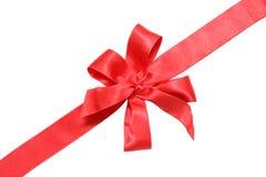 Rotes Farbband und Bogen des Geschenks Lizenzfreie Stockfotos