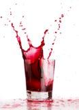 Rotes flüssiges Spritzen Stockbilder