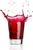 Rotes flüssiges Spritzen Stockbild