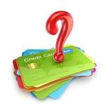 Rotes Fragenkennzeichen auf bunten Kreditkarten. Lizenzfreies Stockfoto