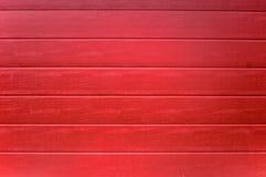 Rotes gemaltes Holz Stockfotografie