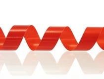 Rotes gerolltes Farbband Stockbilder
