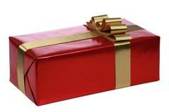 Rotes Geschenk mit Goldfarbbändern Stockbilder